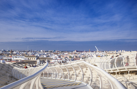 metropol parasol: Roof footbridge for pedestrians at Metropol Parasol. It provides a unique view of the old city center and the cathedral Stock Photo