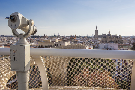 metropol parasol: Turistic telescope pointing to old town landmarks over Metropol Parasol roof, one of the best view of the city of Seville, Spain