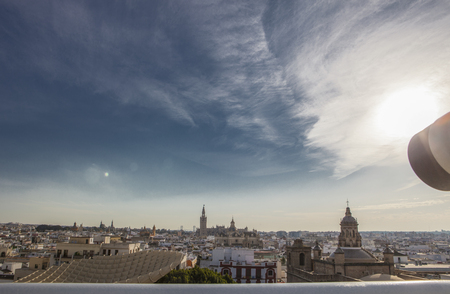 turistic: Turistic telescope pointing to old town landmarks over Metropol Parasol roof, one of the best view of the city of Seville, Spain