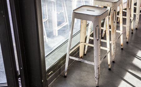 caffe: brass bar stools in vintage caffe. Nice Hotel Lounge Stock Photo