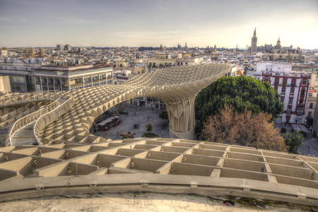 metropol parasol: Views from footbridge over  Metropol Parasol building, Seville, Spain. It provides a unique view of the old city center and the cathedral Stock Photo