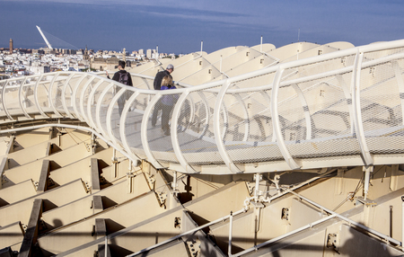 metropol parasol: Seville, Spain - January 2, 2017: Roof footbridge for pedestrians at Metropol Parasol with photographer shadow Editorial