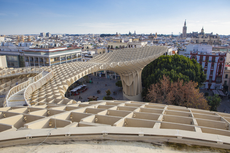 metropol parasol: Seville, Spain - January 2, 2017: Views from footbridge over  Metropol Parasol building, Seville, Spain. It provides a unique view of the old city center and the cathedral