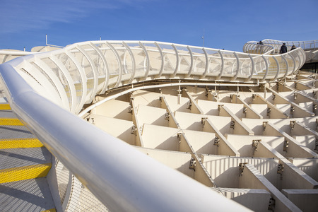 Seville, Spain - January 2, 2017: Roof footbridge for pedestrians at Metropol Parasol. It provides a unique view of the old city center and the cathedral