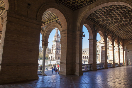 Seville, Spain - January 2, 2017: Spain Square, Plaza de Espana, Seville, Spain. View from porch between arches and columns