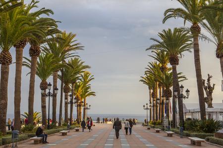 nerja: Nerja, Spain - december 5, 2016: People walking by Europe Balcony promenade, Nerja,  Spain