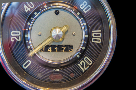 Old car speedometer. Isolated over black background Stock Photo