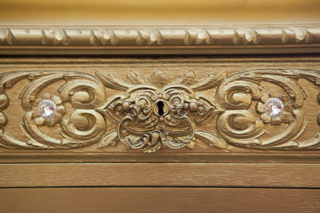 golden section: Golden drawer with crystal handle detail on luxury furniture