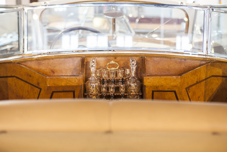 Wet bar detail in a classic luxury car. Wooden interior