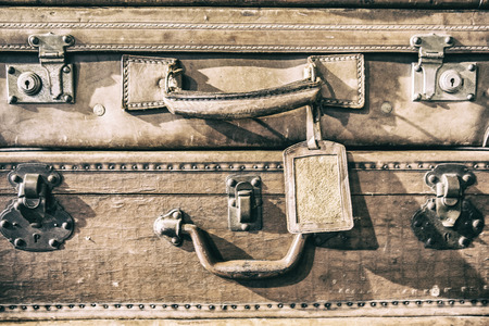 Antique leather luggage suitcases. Detail of handle and locks Stock Photo
