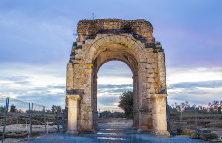 Roman Arch of Caparra at dusk, (1st-2nd century AD). Crossroad ancient city ruins at Silver Route, Via de la Plata, Caceres, Spain