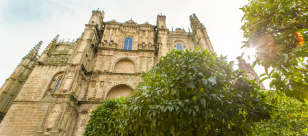 Plasencia New Cathedral. View from orange tree garden, Caceres, Spain. Panoramic Stock Photo