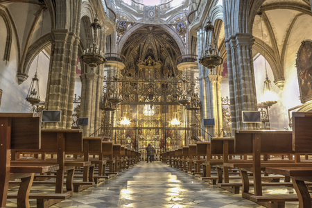 Tourists observing the Virgin of Guadalupe Monastery Basilica, Caceres, Spain