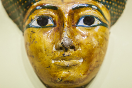 Ancient Egyptian funerary mask, carved and painted wood Stock Photo