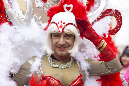 troupe: Badajoz, Spain - February 28, 2017: Mature man  transvestite take part at Badajoz Carnival parade. This is one of the best carnivals in Spain, especially highlighting massive participation of people Editorial