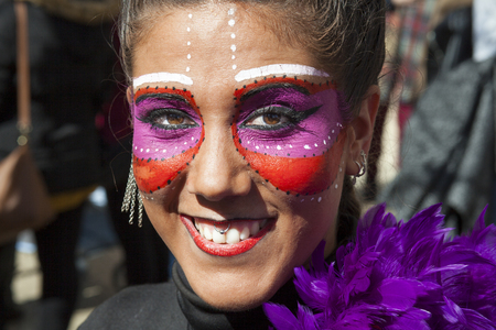 troupe: Badajoz, Spain - February 28, 2017: Young pretty girl portrait at Carnival parade of Badajoz City. This is one of the best carnivals in Spain, especially highlighting massive participation of people