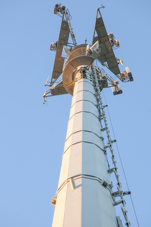 telephone poles: Telephony antenna or base station low angle view with  blue sky blackground Stock Photo