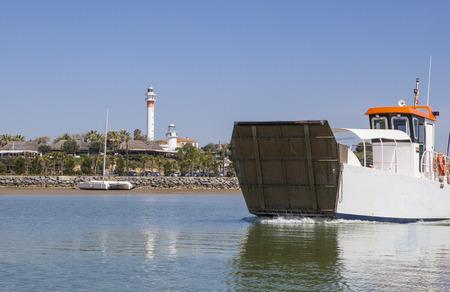 Ferry departs from El Rompido Marina. This little boat only for passengers cross Piedras River to get Atlantic Beach of La Flecha, Cartaya, Huelva, Spain