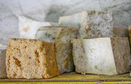 Wooden shelf full of rustic handmade soap, Banos de Montemayor, Spain Stock Photo