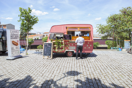 Merida, Spain - May 14, 2017: Pink dotted food truck at the historical city of Merida, Extremadura, Spain