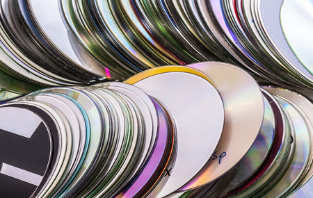 Loads of old used cd disks. Isolated over white background Stock Photo
