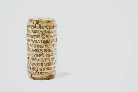 wino: Wine cork with word wine in several languages. Isolated. Vintage filtered