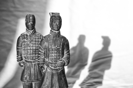 Replicas of two terracotta soldiers. Black and white shot