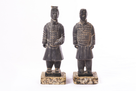 Replicas of two terracotta soldiers. Isolated over white background