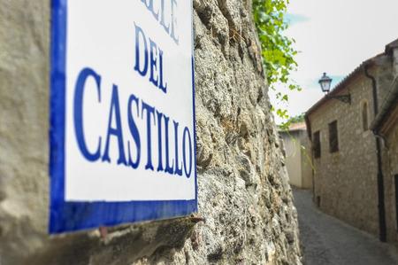 Street sign at stone  houses of Trujillo street, Extremadura, Spain. Old town Stok Fotoğraf