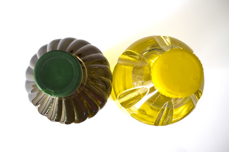 pete: Olive versus sunflower oil bottled in PET. Upper view. Isolated over white