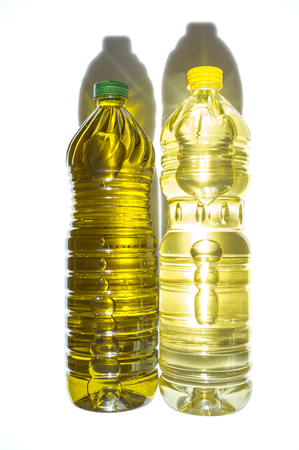 pete: Olive versus sunflower oil bottled in PET. Isolated over white Stock Photo