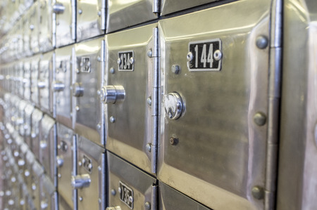 Rows of metal post office boxes. Closeup Stock Photo