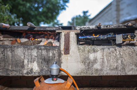 butane: Built in butane gas grill heating up ready to start cooking. Outdoors restaurant Stock Photo