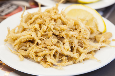 Plate of fried gobies or chanquetes with lemon, Malaga, Spain