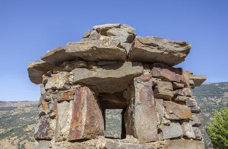 close up chimney: Traditional hat shape chimney at Poqueira Gorge Cottage. Las Alpujarras Region, Granada, Spain
