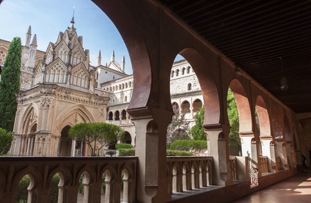 Central building of Guadalupe Monastery cloister from open arcade. Caceres, Extremadura, Spain