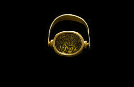 Aliseda, Spain - Octibre 29, 2017: Gold ring with hole for precious stone belong to tartessos treasure of Aliseda. Replica currently kept at Interpretation Centre of Aliseda, Caceres, Spain
