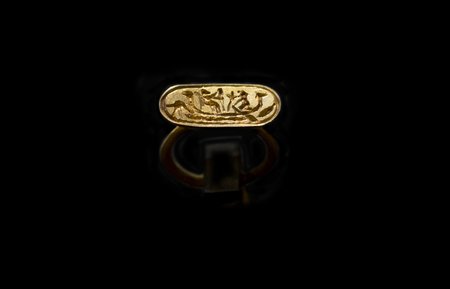 Aliseda, Spain - Octibre 29, 2017: Gold ring with depiction of Nilotic scene belong to tartessos treasure of Aliseda. Replica currently kept at Interpretation Centre of Aliseda, Caceres, Spain