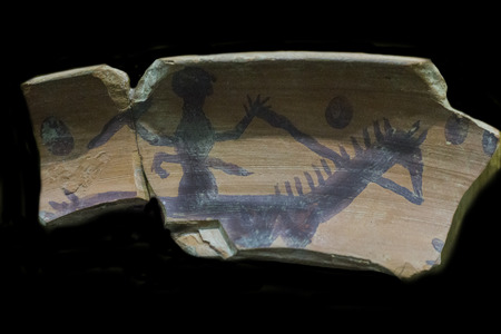Caceres, Spain - October 29, 2017:  Depiction of rider with sword painted over jug clay from Late bronze Age. Caceres Archaeological Museum Editorial