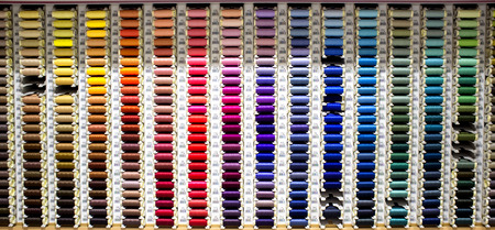 Badajoz, Spain - August 30th, 2017: sewing thread reels on a market stall. Typical background on a notions store