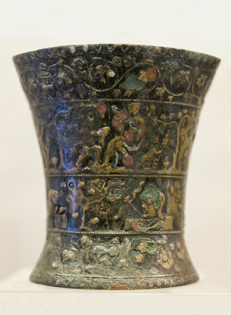 Badajoz, Spain - November 21, 2017: Nertobriga vase. Bronze vessel and silver niello beautifully decorated with Bacchic scenes. Badajoz Archeological Museum