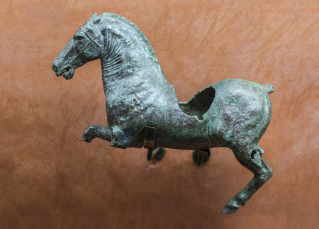 Merida, Spain - December 20th, 2017: Roman figure of wounded galloping horse. National Museum of Roman Art in Merida, Spain