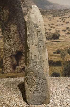 Madrid, Spain - November 11, 2017: Warrior Stela of Magacela. Drawing on the rock belonging to Late Bronze. National Archeological Museum, Madrid