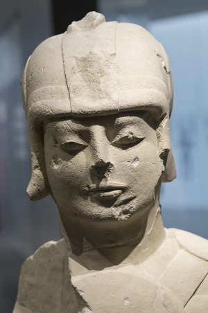 Jaen, Spain - December 29th, 2017: Warrior with double armour at Iberian Museum of Jaen belonging to the Temporary Exhibition tittled The Lady, The Prince, The Hero and the Goddess