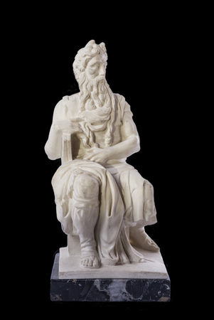 Replica of Michelangelo Moses sculpture, very popular as Rome souvenir. Isolated over black background