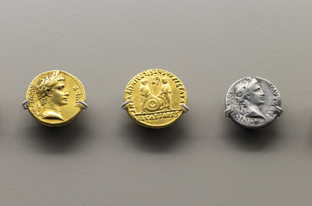 Merida, Spain - December 20th, 2017: Golden and silver roman coins of Augustus Emperor at  National Museum of Roman Art in Merida, Spain
