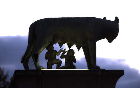 Bronze sculpture of the she-wolf with Romulus and Remus. Silhouette Back view
