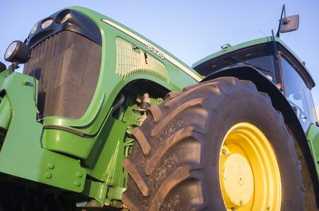 Badajoz, Spain - August 6th, 2017: Row Crop Tractor John Deere 8320. Low side view