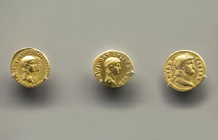 Merida, Spain - December 20th, 2017: Three golden coins of Nero Emperor at National Museum of Roman Art in Merida, Spain
