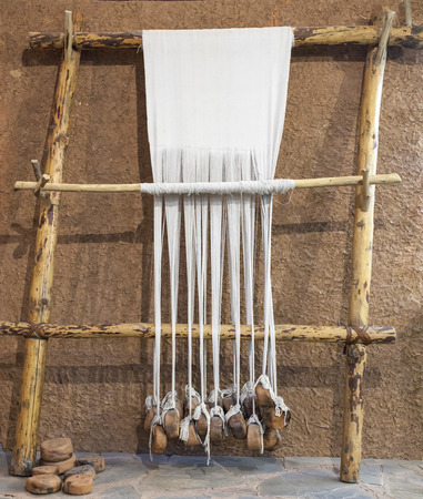 Reconstructed prehistoric age weaving loom. Mudwall ancient house replica 写真素材